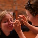 Rebekah gets some makeup applied at Axe And Fiddle.