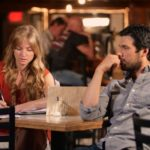 Rebekah and Anthony checking the lines for a scene.